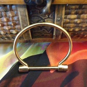 Gold tone screw on cuff bracelet.